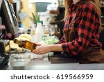 cropped photo of cashier lady... | Shutterstock . vector #619566959