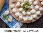 Dumplings Raw On A Round Board...