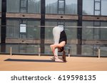 young lady practicing yoga on... | Shutterstock . vector #619598135
