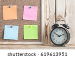 Time Management Concept With Alarm Clock On Wooden Shelf And Reminder Color Papers On Cork Board - stock photo