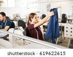 cute young female tailor... | Shutterstock . vector #619622615