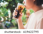 woman drinking a glass of cola... | Shutterstock . vector #619622795