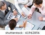 four businesswomen sitting at... | Shutterstock . vector #61962856
