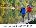 Two Fishermen With Fishing Rod...