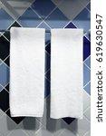 towels hanging in a bathroom | Shutterstock . vector #619630547
