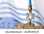 Menorah In Front Of A Blue And...