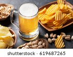 lager beer and snacks on stone... | Shutterstock . vector #619687265