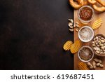 lager beer and snacks on stone... | Shutterstock . vector #619687451