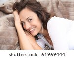 beautiful woman relaxing on a... | Shutterstock . vector #61969444
