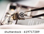 repairing damaged smart phone... | Shutterstock . vector #619717289