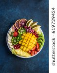delicious fruits and berries...   Shutterstock . vector #619729424