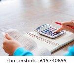 woman working with calculator ... | Shutterstock . vector #619740899