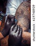 professional tattooer create... | Shutterstock . vector #619748939