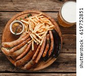 mug with cold tasty beer and... | Shutterstock . vector #619752851