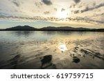 sunlight reflected in the ocean ...   Shutterstock . vector #619759715