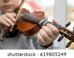 child hands playing the violin | Shutterstock . vector #619805249
