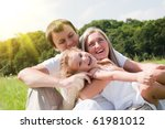 playful family on the meadow | Shutterstock . vector #61981012