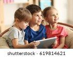 cute kids using digital tablet | Shutterstock . vector #619814621