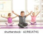 group of children doing... | Shutterstock . vector #619814741