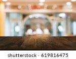 empty wooden table in front of... | Shutterstock . vector #619816475