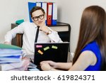a young businessman with... | Shutterstock . vector #619824371