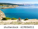 mountain biker riding on bike... | Shutterstock . vector #619836011