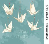 background with paper cranes.... | Shutterstock .eps vector #619854371