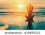 meditation yoga silhouette of... | Shutterstock . vector #619855121