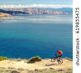 mountain biker riding on bike... | Shutterstock . vector #619855475