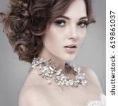 a portrait of elegant girl is...   Shutterstock . vector #619861037