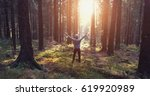 young man stand in forrest and... | Shutterstock . vector #619920989