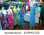 woman dresses for sell at night ... | Shutterstock . vector #619941155