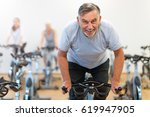 mature man in health club  | Shutterstock . vector #619947905