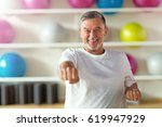 mature man in health club  | Shutterstock . vector #619947929