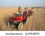 SINAI MOUNTAINS DESERT NEAR SHARM EL SHEIKH, EGYPT - MARCH 9: Unidentified people on quad trip in Egypt - one of the local travel attraction March 9, 2010 in Egypt - stock photo