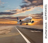 a passenger plane flying in the ... | Shutterstock . vector #619954451