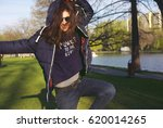 cool urban hipster girl wearing ... | Shutterstock . vector #620014265