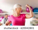 confident mature woman showing... | Shutterstock . vector #620042801