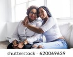 a affectionate mother and... | Shutterstock . vector #620069639