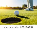Professional Golfer Putting...