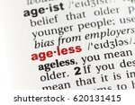 Small photo of Closeup of English dictionary page with word AGELESS.