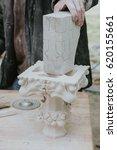 restorer fixes piece of white ...   Shutterstock . vector #620155661