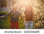 two beautiful young women are... | Shutterstock . vector #620206685