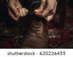 closeup of  hands tying the...   Shutterstock . vector #620226455