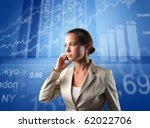 Businesswoman talking to telephone with exchange graphics on the background - stock photo