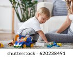 cute mother and child boy play... | Shutterstock . vector #620238491