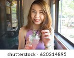young asian woman smiling and... | Shutterstock . vector #620314895