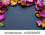 frame of dry rose petals on a... | Shutterstock . vector #620320655