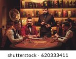 group of men playing poker in... | Shutterstock . vector #620333411