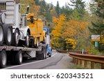 big blue semi truck with a flat ... | Shutterstock . vector #620343521